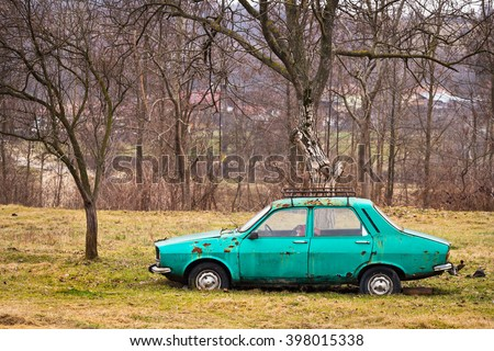 VALCEA, ROMANIA - February 28, 2016: Abandoned Dacia car left to rust in a garden. Dacia 1300 was an iconic romanian car in communist period, produced under Renault 12 license - stock photo