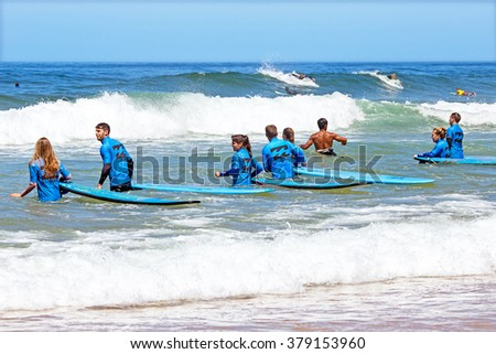 VALE FIGUEIRAS, PORTUGAL - August 20 2014: Surfers getting surfers lessons on the famous surfers beach Vale Figueiras in Portugal - stock photo