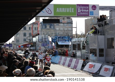 VALENCE, FRANCE - MAR 02: Romain Bardet wins La Classic Drome UCI Europe Tour Pro Race on March 02, 2014 in Valence, Drome, France.  - stock photo