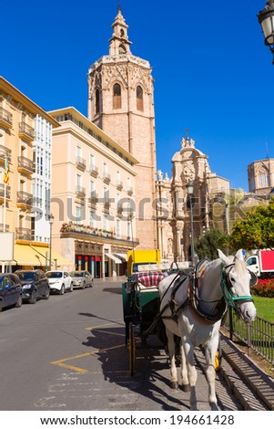 Valencia cathedral and Miguelete in plaza de la Reina square Spain - stock photo