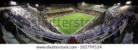 VALENCIA - JANUARY 25: Crowd of people in Mestalla stadium during Spanish League match, on January 25, 2014, in Valencia, Spain.  - stock photo