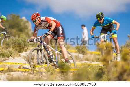 VALENCIA - MARCH 6: Marc Montero rider participates in international Chelva MTB-XCO competition in Chelva on march 6, 2016 in Valencia, Spain - stock photo