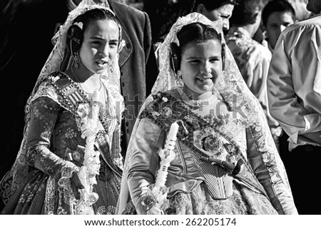 VALENCIA - MAY 9, 2011: A pair of unidentified children wearing traditional costumes participate in Costume Parade during the celebrations held in commemoration of Saint Joseph - stock photo