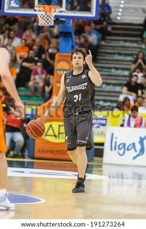 VALENCIA - MAY, 3: Raul Lopez drives the ball during a Spanish league match between Valencia Basket Club and Bilbao at the Fonteta Stadium on May 3, 2014 in Valencia, Spain