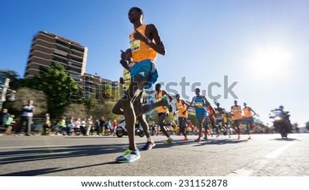 VALENCIA - NOVEMBER 16: Leading group of runners participate in Valencias marathon on November 16, 2014 in Valencia, Spain - stock photo