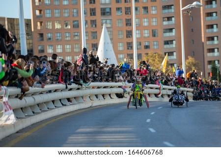 VALENCIA - NOVEMBER 17: Paco Valen leads hand-bike group during his participation in Valencias Marathon on November 17, 2013 in Valencia, Spain - stock photo