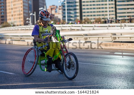 VALENCIA - NOVEMBER 17: Paco Valen (number 98) hand-biker participates over his handicapped wheel chair in Valencias Marathon on November 17, 2013 in Valencia, Spain - stock photo