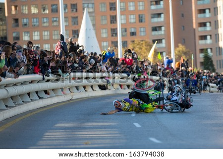 VALENCIA - NOVEMBER 17: Paco Valen (number 98) hand-biker starts marathon with an accident over his handicapped wheel chair in Valencias Marathon on November 17, 2013 in Valencia, Spain - stock photo