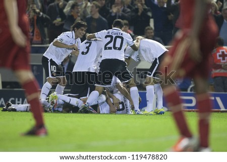 VALENCIA - NOVEMBER 20: Valencia Team players celebrating a goal during UEFA Champions League match between Valencia CF and FC Bayer Munchen, on November 20, 2012, in Mestalla Stadium, Valencia, Spain