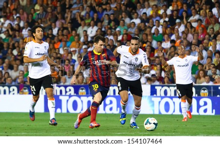 VALENCIA - SEP, 01: Leo Messi of FC Barcelona in action during a Spanish League match between Valencia CF and FC Barcelona at the Mestalla Stadium on September 01, 2013 in Valencia, Spain - stock photo