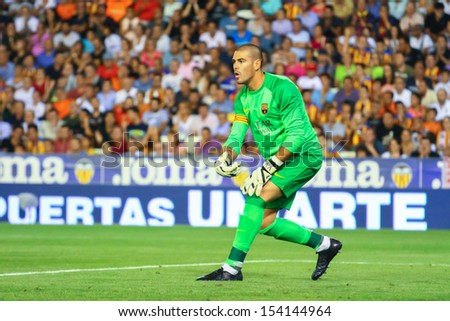 VALENCIA - SEP, 01: Victor Valdes of FC Barcelona in action during a Spanish League match between Valencia CF and FC Barcelona at the Mestalla Stadium on September 01, 2013 in Valencia, Spain - stock photo