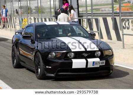 VALENCIA, SPAIN - APRIL 25: A black 2013 Ford Mustang take part in American Fest weekend organizated in circuit Ricardo Tormo, on April 25, 2015, in Cheste, Valencia, Spain. - stock photo