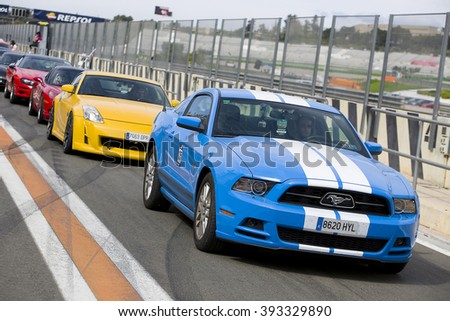 VALENCIA, SPAIN - APRIL 25: A blue 2013 Ford Mustang take part in American Fest weekend organized in circuit Ricardo Tormo, on April 25, 2015, in Cheste, Valencia, Spain. - stock photo