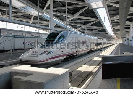 VALENCIA, SPAIN - APRIL 16, 2012: AVE hig speed train in Joaquin Sorolla station, Valencia. Most spanish provinces are connected by this modern transportation medium - stock photo