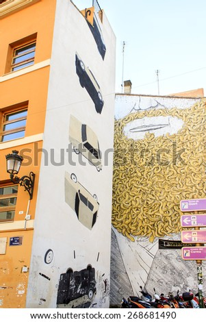 VALENCIA, SPAIN - APRIL 4 : Graffiti paintings on the side part of the building in Valencia, Spain on April 4th, 2014 - stock photo
