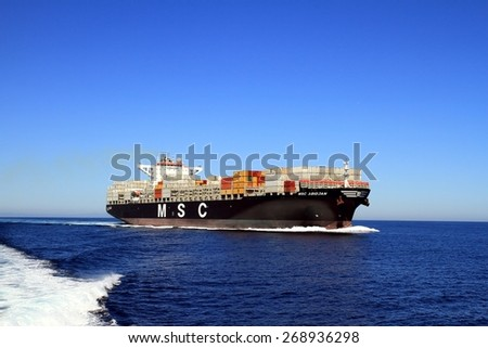 "VALENCIA, SPAIN -?? APRIL 09: Starboard side view of the container ship ""MSC ABIDJAN"" after leaving the port of Valencia is sailing in open waters, on april 09, 2015 in Valencia."