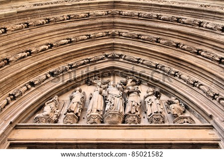 Valencia, Spain. Architecture detail of famous Cathedral - Virgin Mary and angels with musical instruments.