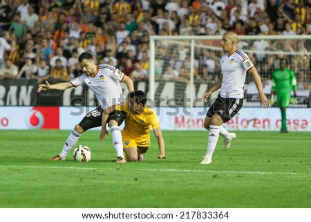 VALENCIA, SPAIN - AUGUST 29: Valencia CF and Malaga CF players in action at the Spanish League game between Valencia CF and Malaga CF at Mestalla Stadium on August 29, 2014 in Valencia, Spain - stock photo