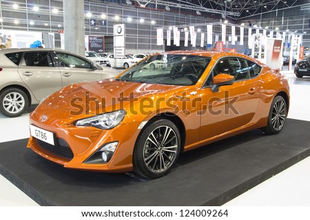 VALENCIA, SPAIN - DECEMBER 7 - A Orange 2012 Toyota GT 86 Sports Car at the Valencia Car Show on December 7, 2012 in Valencia, Spain.