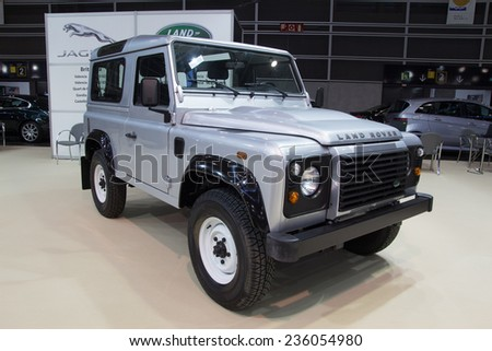 VALENCIA, SPAIN - DECEMBER 4, 2014: A silver 2013 Land Rover Defender at the Valencia Automovil 2014 Car Show. Production of the Defender model began in 1983. - stock photo