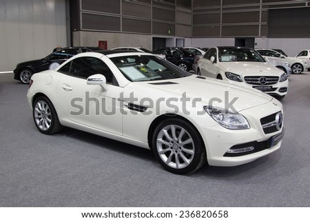 VALENCIA, SPAIN - DECEMBER 4, 2014: A white 2014 Mercedes SLK55 AMG Roadster  at the Valencia Automovil 2014 Car Show. The SLK 55 AMG was first unveiled in 2011 Frankfurt Motor Show. - stock photo