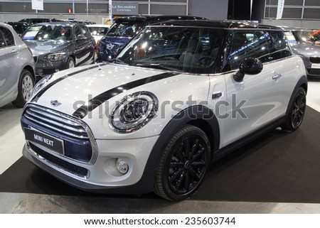VALENCIA, SPAIN -DECEMBER 4, 2014:  A white 2014 Mini Cooper at the Valencia Automovil 2014 Car Show. Mini Coopers are currently produced by BMW. - stock photo