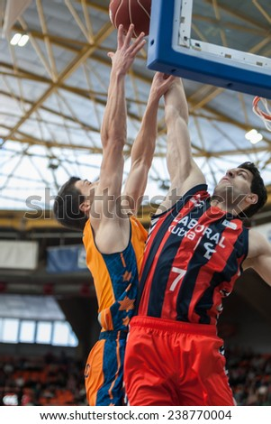 VALENCIA, SPAIN - DECEMBER 7:  Lucic (L) with ball during Endesa Spanish League game between Valencia Basket Club and Laboral Kutxa Baskonia at Fonteta Stadium on December 7, 2014 in Valencia, Spain