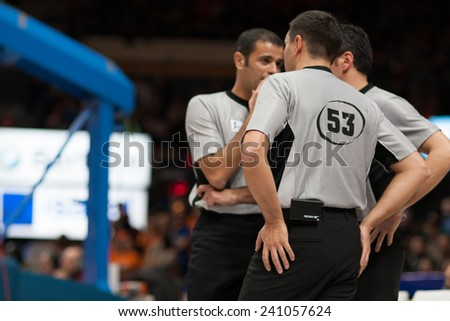 VALENCIA, SPAIN - DECEMBER 30: Referees during Spanish League match between Valencia Basket Club and Juventut at Fonteta Stadium on December 30, 2014 in Valencia, Spain - stock photo