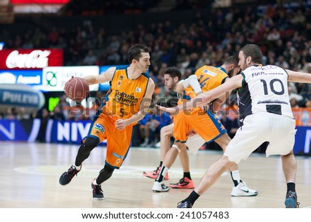 VALENCIA, SPAIN - DECEMBER 30: Ribas with ball during Spanish League match between Valencia Basket Club and Juventut at Fonteta Stadium on December 30, 2014 in Valencia, Spain