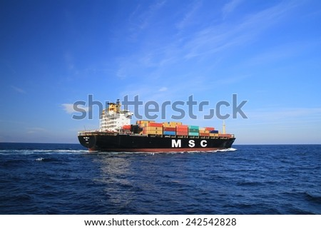 "VALENCIA, SPAIN � DECEMBER  20: The container ship ""MSC MIRELLA"" after leaving the port of Valencia is sailing in open waters, on december 20, 2014 in Valencia. - stock photo"