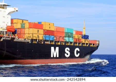 """VALENCIA, SPAIN � DECEMBER  20: The container ship """"MSC MIRELLA"""" after leaving the port of Valencia is sailing in open waters, on december 20, 2014 in Valencia. - stock photo"""