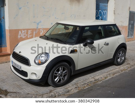 VALENCIA, SPAIN - FEBRUARY 22, 2016: A Mini Cooper car parked in the street in Valencia, Spain. In 1999 the Mini was voted the second most influential car of the 20th century, behind the Ford Model T. - stock photo