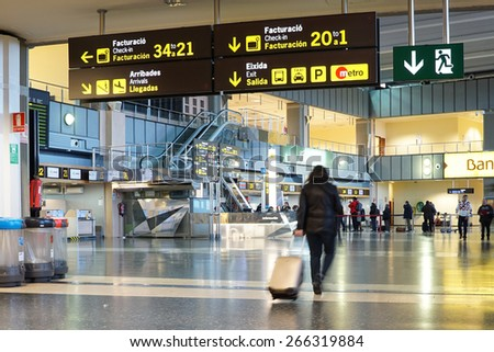 VALENCIA, SPAIN - FEBRUARY 14, 2015: Airline passengers inside the Valencia Airport. About 4.59 million passengers passed through the airport in 2013. - stock photo