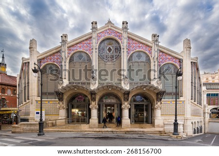 VALENCIA, SPAIN - FEBRUARY 17: People shopping entering the main entrance of the old central market, one of the most attractive and visited buildings, on February 17, 2015 in Valencia, Spain. - stock photo