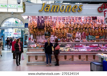 VALENCIA, SPAIN - FEBRUARY 17: People shopping in the old central market, one of the most attractive and visited buildings, on February 17, 2015 in Valencia, Spain. - stock photo