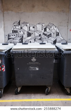 VALENCIA, SPAIN - FEBRUARY 09, 2015: refuse container with a creative wall painting in the old town of Valencia. Valencia is the capital of the same named province and the 3rd largest city in Spain. - stock photo