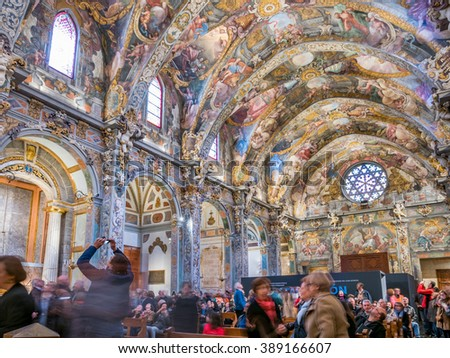 VALENCIA, SPAIN - FEBRUARY 28: Unidentified tourists enjoy a tour inside St. Nicholas Chapel (also known as Valencian Sistine Chapel) on February 28, 2016