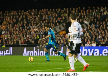 VALENCIA, SPAIN - JANUARY 25: Bacca with ball during Spanish League match between Valencia CF and Sevilla FC at Mestalla Stadium on January 25, 2015 in Valencia, Spain - stock photo