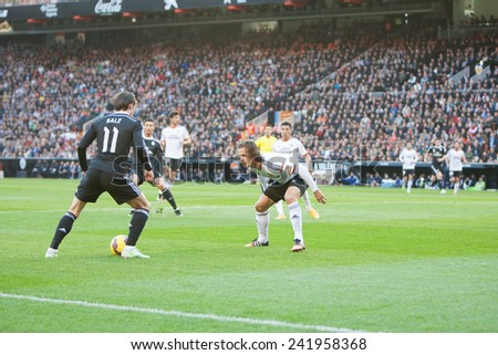 VALENCIA, SPAIN - JANUARY 4: Bale with ball and Orban during Spanish League match between Valencia CF and Real Madrid at Mestalla Stadium on January 4, 2015 in Valencia, Spain - stock photo