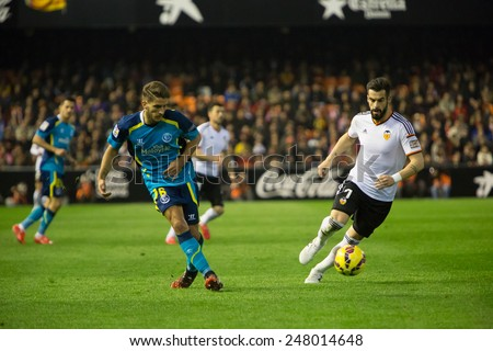 VALENCIA, SPAIN - JANUARY 25: Carrico (L) and Negredo during Spanish League match between Valencia CF and Sevilla FC at Mestalla Stadium on January 25, 2015 in Valencia, Spain - stock photo
