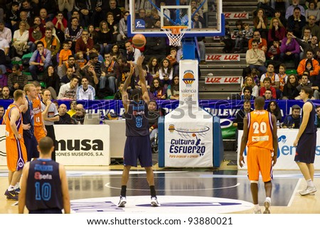 VALENCIA, SPAIN - JANUARY 28: Cedric Simmons (#9 player) free shot during the ACB league match between Valencia Basket  and Asefa Estudiantes, 85-71, on January 28, 2012, in Valencia, Spain - stock photo