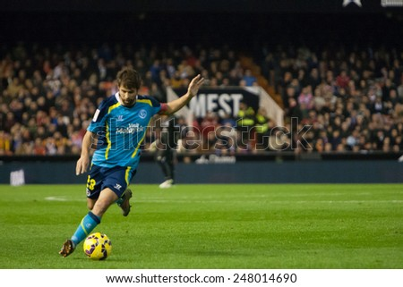 VALENCIA, SPAIN - JANUARY 25: Coke in action with a ball during Spanish League match between Valencia CF and Sevilla FC at Mestalla Stadium on January 25, 2015 in Valencia, Spain - stock photo