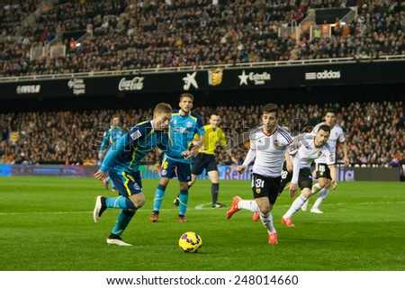 VALENCIA, SPAIN - JANUARY 25: Deulofeu (L) in action during Spanish League match between Valencia CF and Sevilla FC at Mestalla Stadium on January 25, 2015 in Valencia, Spain - stock photo