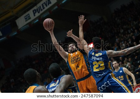 VALENCIA, SPAIN - JANUARY 24: Dubljevic with ball and Lima during Spanish League match between Valencia Basket Club and UCAM Murcia at Fonteta Stadium on January 24, 2015 in Valencia, Spain - stock photo