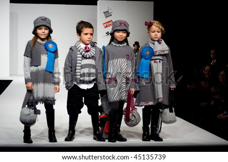 VALENCIA, SPAIN - JANUARY 23: FIMI Children's Winter Fashion Show with the designer Floc Baby on the runway in the Feria Valencia on January 23, 2010 in Valencia, Spain. - stock photo