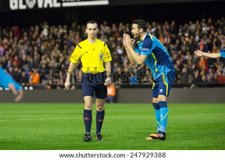 VALENCIA, SPAIN - JANUARY 25: Iborra (R) and referee Jaime Latre during Spanish League match between Valencia CF and Sevilla FC at Mestalla Stadium on January 25, 2015 in Valencia, Spain - stock photo