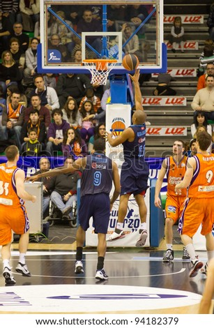 VALENCIA, SPAIN - JANUARY 28: Jayson Granger (blue shirt) scoring during the ACB league match between Valencia Basket  and Asefa Estudiantes, 85-71, on January 28, 2012, in Valencia, Spain - stock photo