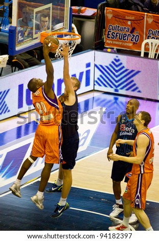 VALENCIA, SPAIN - JANUARY 28: Pietrus (Valencia basket player) in action during the ACB league match between Valencia Basket  and Asefa Estudiantes, 85-71, on January 28, 2012, in Valencia, Spain - stock photo