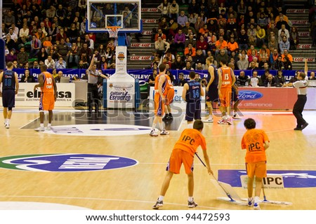 VALENCIA, SPAIN - JANUARY 28: Players of both teams in action during the ACB league match between Valencia Basket and Asefa Estudiantes, 85-71, on January 28, 2012, in Valencia, Spain - stock photo