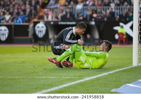 VALENCIA, SPAIN - JANUARY 4: Ronaldo (L) and Diego Alves during Spanish League match between Valencia CF and Real Madrid at Mestalla Stadium on January 4, 2015 in Valencia, Spain - stock photo